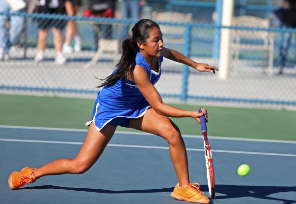 Bishop Gorman sophomore Amber Del Rosario digs to return a ball during a Division I state championship match against Palo Verde. Del Rosario was 3-0 in singles to help the Gaels claim the title.
