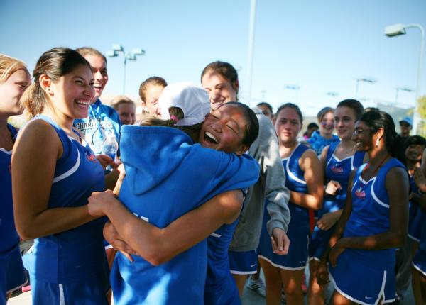 Bishop Gorman sophomore Amber Del Rosario, center, hugs senior teammate Julia MacDonald after winning Division I state championship.