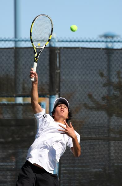 Clark junior Andrew Lim serves during a Division I-A state championship match against Truckee on Friday.
