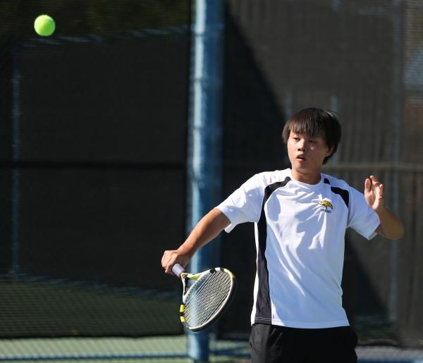 Clark senior Deric Pang returns the ball during a Division I-A state championship match against Truckee on Friday.