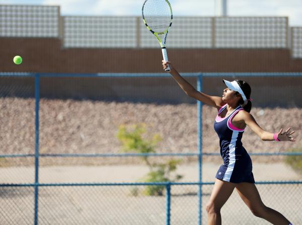The Meadows senior Anjali Daulat returns the ball during a Division I-A state championship match against Faith Lutheran. Daulat and the Mustangs won, 12-6.