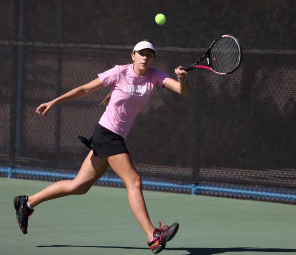 Faith Lutheran junior Kathleen Wright returns the ball during a Division I-A state championship match against The Meadows