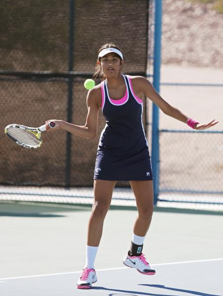 The Meadows senior Anjali Daulat returns the ball during a Division I-A state championship match against Faith Lutheran on Friday.