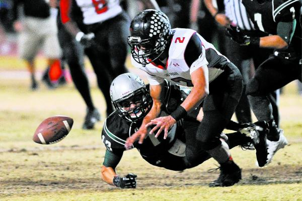 Las Vegas Jacob Littlefield (2) fights to recover a fumble by Green Valley's Kyler Chavez (13) on Friday. Littlefield recovered a fumble, intercepted a pass and had a sack.
