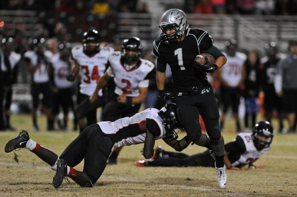 Green Valley wide receiver Giovanni Hernandez, sidestepping Las Vegas linebacker Elias Miller in the Gators' 39-38 victory on Oct. 11, has 32 receptions for 606 yards and 10 touchdowns this seas ...