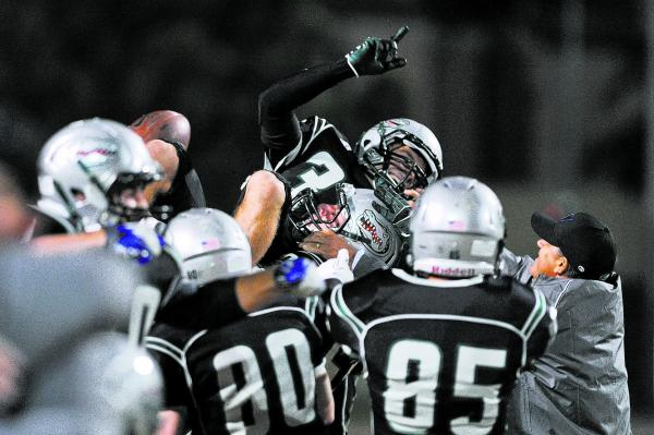 Green Valley's Conor Perkins (33) is lifted up by his teammates after making a game-winning 37-yard field goal on Friday. Perkins' boot as time expired gave the Gators a 39-38 win over Las Vegas.