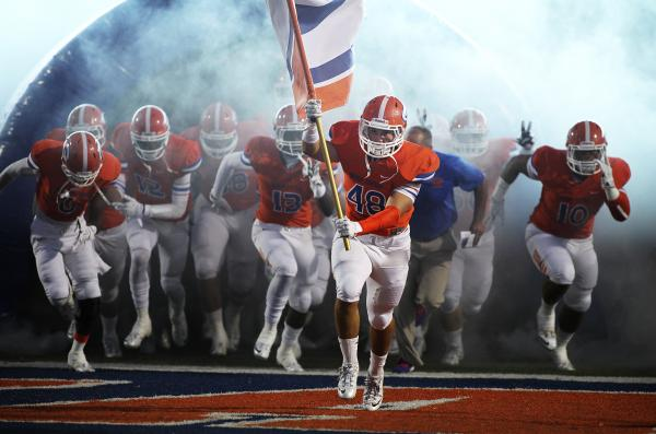 Senior linebacker Chris Lalli leads the Bishop Gorman football team onto the field against Crespi (Calif.) earlier this season. The Gaels host Booker T. Washington of Miami, the nation's No. 1 ran ...