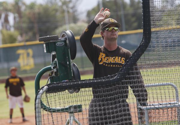 Bonanza baseball coach Derek Stafford feeds baseballs into a pitching machine at practice Tuesday. The Bengals open play in the Division I state tournament Thursday against Reno at CSN.