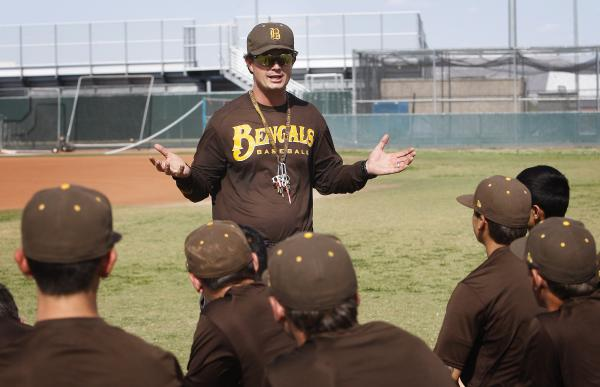 Bonanza baseball coach Derek Stafford addresses his team at practice on Tuesday.