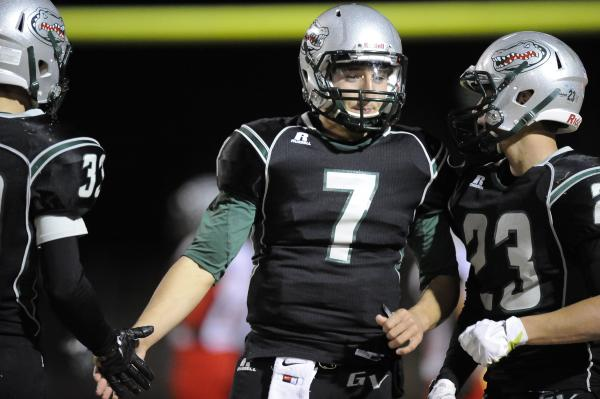 Green Valley quarterback Christian Lopez (7) receives congratulations from Conor Perkins, left and Albert Lake, right after a touchdown in the second quarter.
