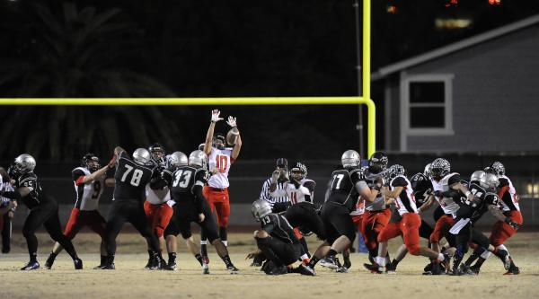Las Vegas' Antonio Jauregui (10) leaps to try to block a field goal attempt by Green Valley's Conor Perkins (33).