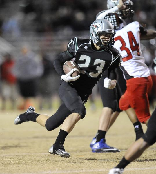 Green Valley's Albert Lake carries the ball in the second quarter.