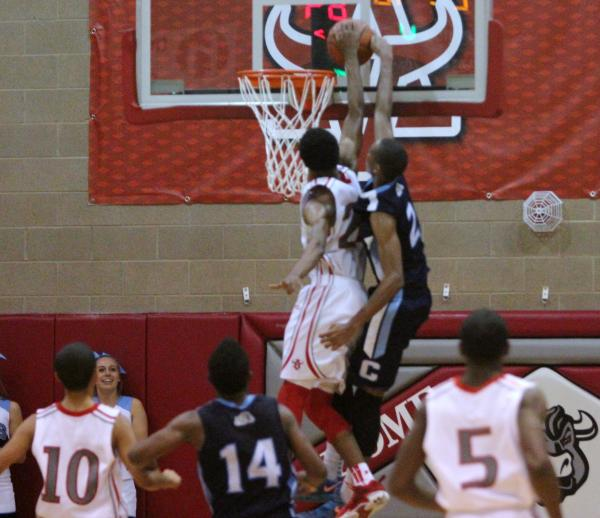 Arbor View's Justin Burks, right, prevents a dunk by Centennial's Troy Brown in the fourth quarter on Friday. Burks was whistled for a foul on the play.