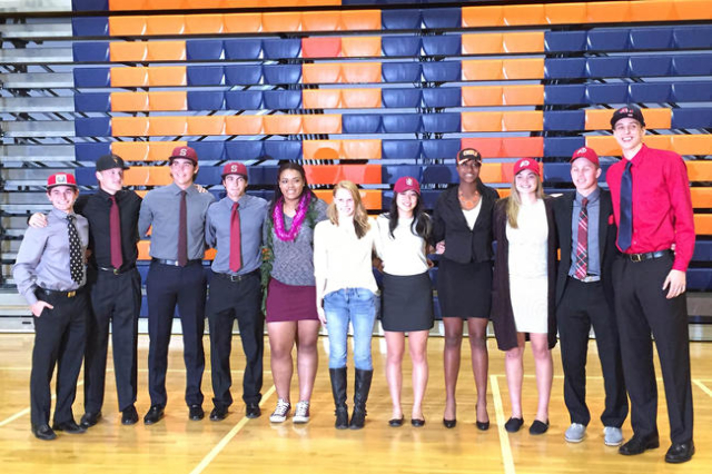 All eleven Bishop Gorman student-athletes pose after signing their National Letters of Intent on Nov. 11, 2015. (Ashton Ferguson/Las Vegas-Review Journal)