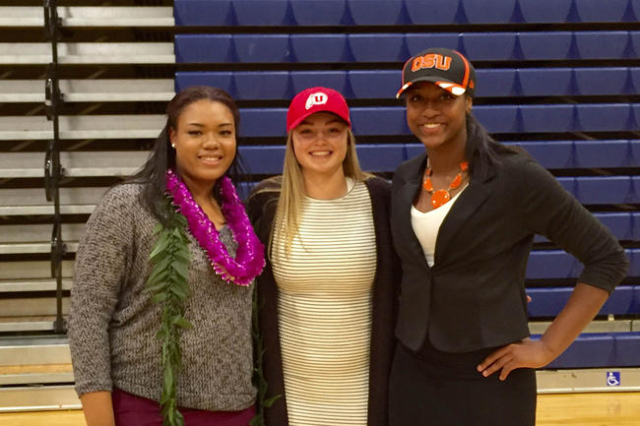 Bishop Gorman girls basketball players (from left) Raychel Stanley, Megan Jacobs and Madison Washington pose together after signing their National Letters of Intent on Nov. 11, 2015. (Ashton Fergu ...