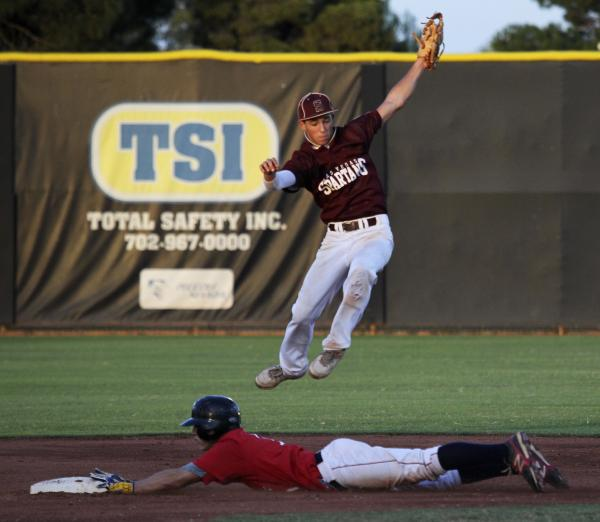 Liberty's Preston Pavlica steals second as Cimarron-Memorial's Logan Bottrell leaps to try to corral the throw.