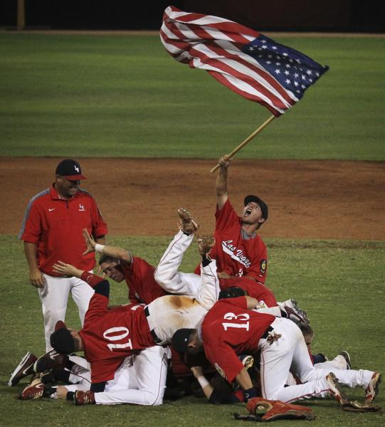 Liberty players celebrate their win over Cimarron-Memorial in the American Legion state championship game.
