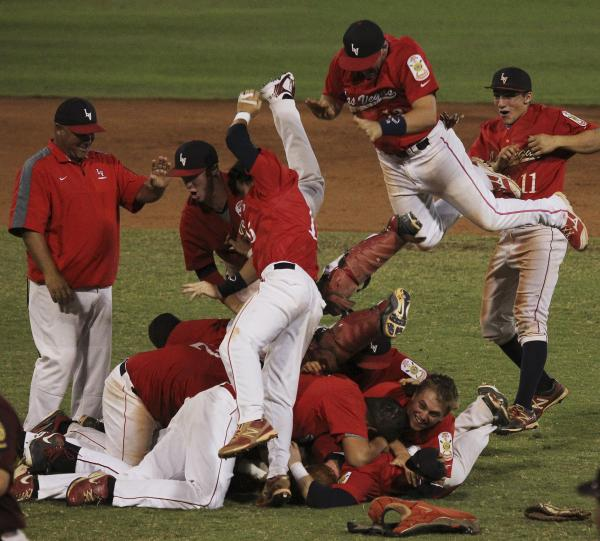 Liberty's baseball team celebrates Saturday after clinching its second straight American Legion state title. The Patriots open play in the Western Regional today in Surprise, Ariz.