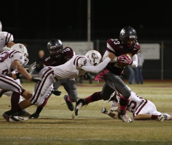 Cimarron-Memorial wide receiver Djon Watson breaks a tackle in the first quarter on Friday against Desert Oasis.