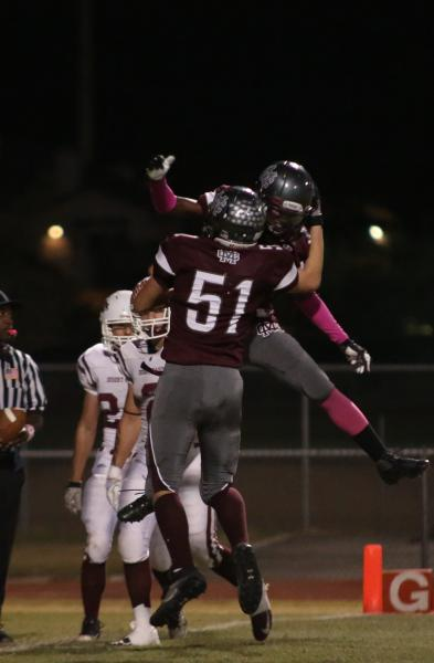 Cimarron-Memorial gaurd Gavin Dean (51) celebrates a first-quarter touchdown on Friday during the Spartans' 34-21 win over Desert Oasis.