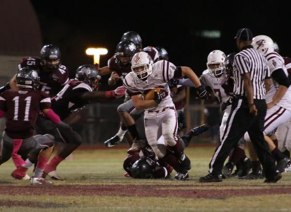 Desert Oasis fullback Blake Kutz rushes the football in the second quarter on Friday against Cimarron-Memorial. Kutz rushed for 70 yards and a touchdown, but the Spartans topped the Diamondbacks,  ...