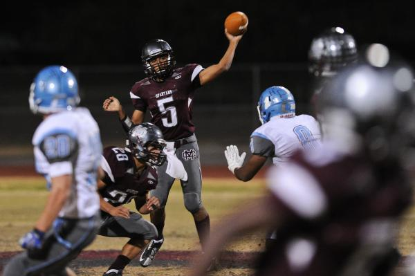 Cimarron's Derek Morefield (5) looks to throw the ball Thursday against Centennial.