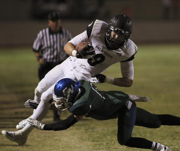 Green Valley's Jacob Rivero (6) makes an open-field tackle against Palo Verde's Jake Ortale (9) on Friday. Ortale caught a pair of TD passes for Palo Verde, but the Gators edged the visiting Panth ...