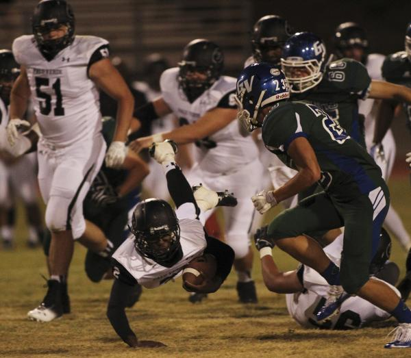 Palo Verde's Hykeem Massey (2) dives for a first down in front of Green Valley's Albert Lake (23) on Friday. Massey rushed for 104 yards on 15 carries.