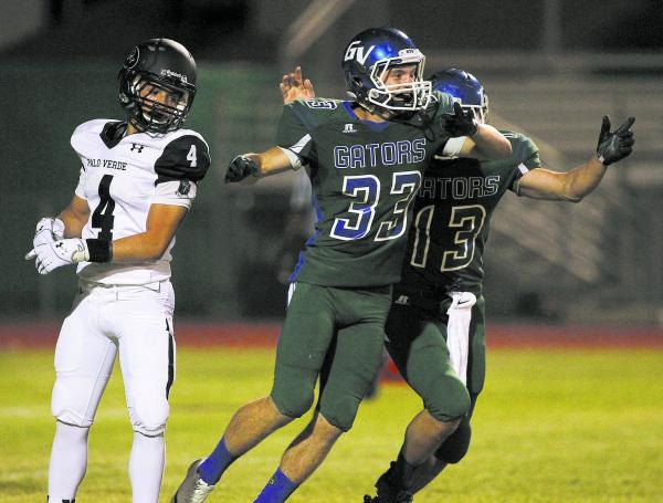 Green Valley kicker Conor Perkins (33) celebrates with holder Kyler Chavez (13) after making the winning extra point in overtime in a 42-41 victory over visiting Palo Verde.