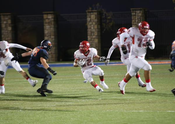 Arbor View's Gage Motl (12) evades a tackler on Friday during the Sunset Region semifinal game at Bishop Gorman on Friday.