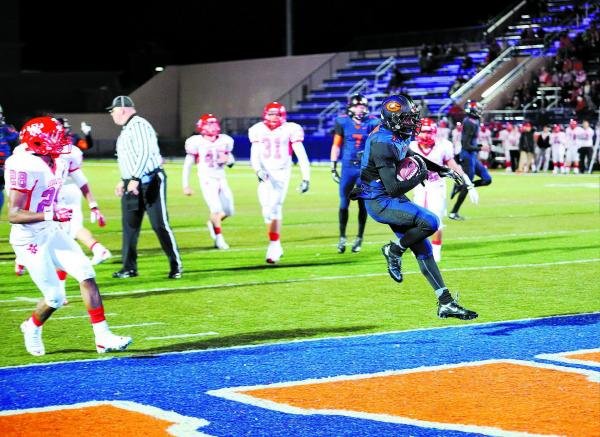 Bishop Gorman half back, Daniel Stewart (1), rushes for a touchdown during the second quarter at the Sunset Region semifinal football game on Friday. Stewart ran for 152 yards anf four TDs on 10 c ...