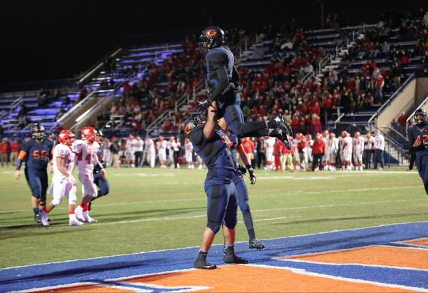 Bishop Gorman running back Daniel Stewart (1) is given a congratulatory lift after scoring a touchdown on Friday. Steart had four TD runs in a 52-7 win over Arbor View.