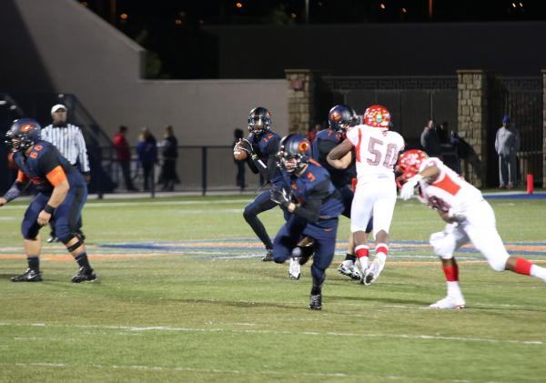 Bishop Gorman quarterback Randall Cunningham looks for a receiver on Friday night. Cunningham completed 6 of 13 passes for 103 yards and a touchdown in a 52-7 win.