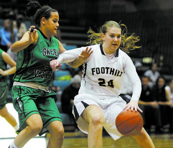 Foothill's Gabby Doxtator, right, drives by Milena Palor of Green Valley on Tuesday night.