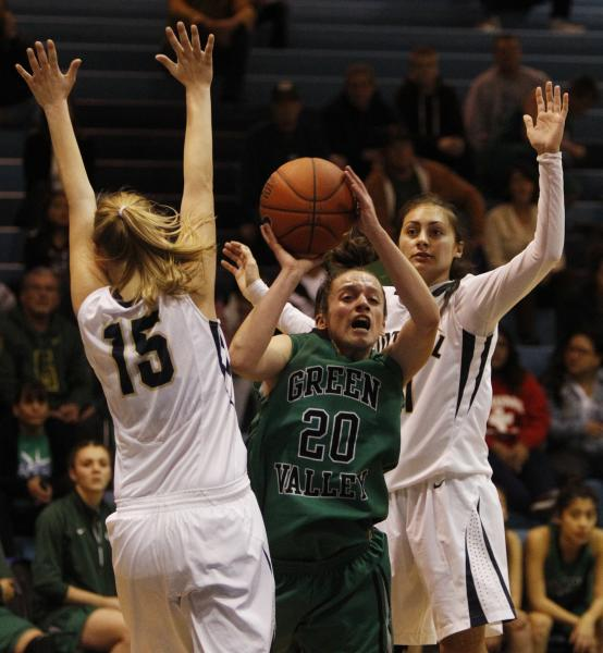 Foothill's Nicole Benson, left, and Taylor Turney surround Green Valley's Rianna Rudolph on Tuesday.