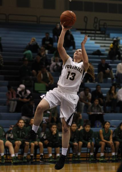Foothill's Kelsey McFarland goes up for a shot against Green Valley on Tuesday. McFarland had 24 points and 10 rebounds in a 68-61 win.