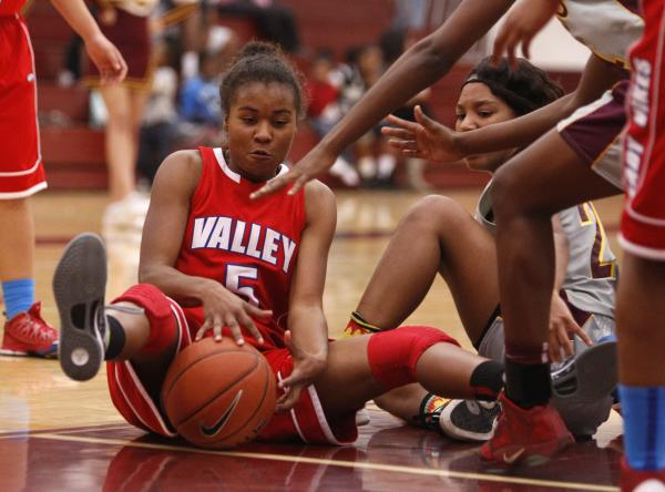 Valley's Kennedy Wharton (5) tries to control the ball as Eldorado's Cecilley Hall, right, looks on.