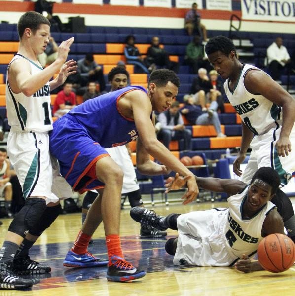 Gorman's Chase Jeter (4) and Sheldon's L.J. Williams (5) scramble for a loose ball on Thursday during the Tarkanian Classic.