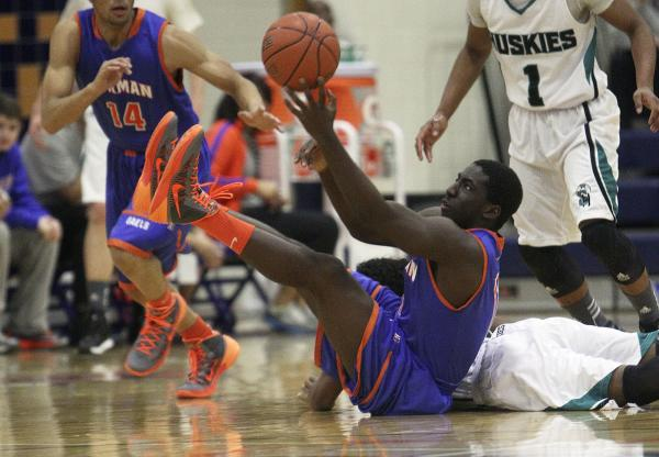 Gorman's Obim Okeke (11) grabs a loose ball against Sheldon (Calif.) on Thursday during the Tarkanian Classic. Okeke hit a 3-pointer in the second half to break a 43-43 tie, and the Gaels went on  ...