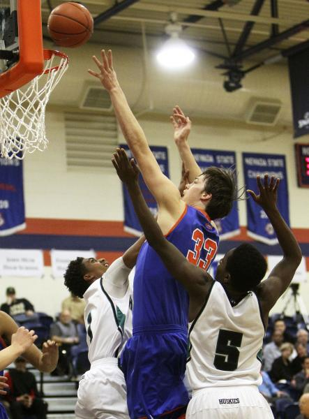 Gorman's Stephen Zimmerman tries for a basket while being double-teamed by Sheldon's Elishja Duplechan (1) and L.J. Williams (5) on Thursday. Zimmerman had 10 points and 12 rebounds in Gorman's 65 ...