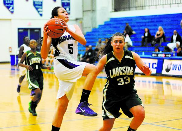 Durango basketball player Jazmin Chavez (5), center, goes in for a layup against Kianna Williams (33) of Lakeside in the championship game of the Lady Wolves Holiday Tournament on Saturday. Chavez ...