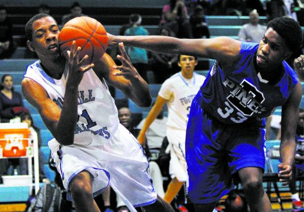 Foothill's Torrance Littles (21) fights for a loose ball against Desert Pines' Timothy Jeffries (33) on Thursday. Littles had 10 points and four blocked shots in Foothill's 63-53 win at the Foothi ...