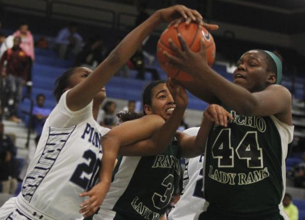 Rancho's LaKissa Martin (44) and Miyah Wilson (3) battle Canyon Springs' Alexia Thrower (20) for a loose ball on Tuesday.