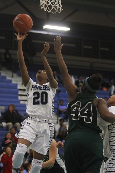 Canyon Springs' Alexia Thrower (20) goes in for a layup past Rancho's LaKissa Martin (44) on Tuesday.