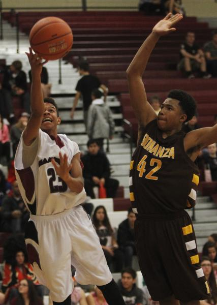 Desert Oasis' Rodrick Moore (23) shoots past Bonanza's Davian Jordan (42) on Friday. Moore scored 25 points to lead the Diamondbacks to a 70-61 win, snapping a 12-game league losing streak.