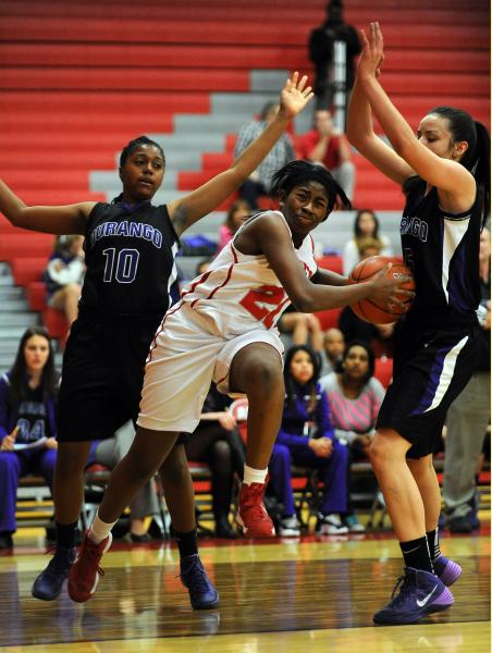 Arbor View's Jocelyn Jordan (21) drives to the basket between Durango's Taylor Gray (10) and Jazmin Chavez on Tuesday.