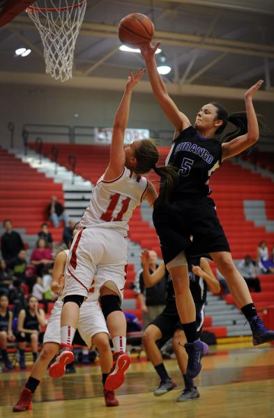 Durango's Jazmin Chavez (5) blocks a shot by Arbor View's Kelsey Rasore on Tuesday.