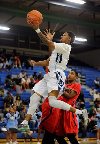Canyon Springs' Shaquile Carr drives past Las Vegas' Tyshon Raybon and Patrick Savoy on Wednesday.
