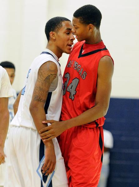Canyon Springs' Darrell McCall, left, and Las Vegas' Darrell McCall share a few words during their game on Wednesday.