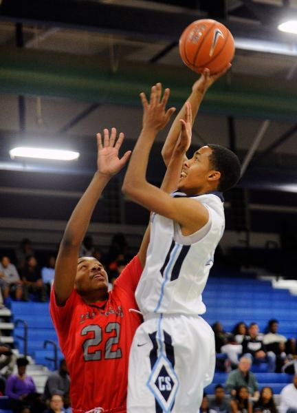 Canyon Springs' Darrell McCall shoots over Las Vegas' Patrick Savoy on Wednesday.